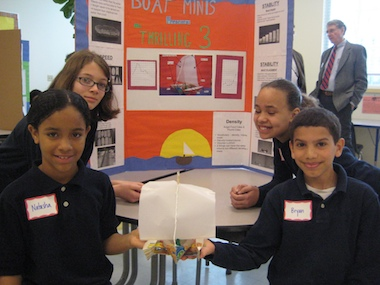 This team's presentation was impressive (background) and its trimaran was one of the more sophisticated at Paul Cuffee School.