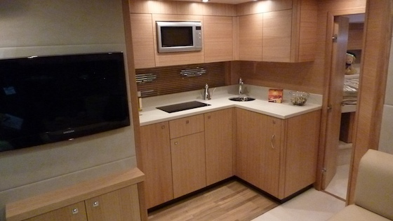 Below, in the main saloon, there's a small but efficient galley.