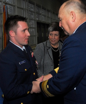 Petty Officer 2nd Class Ben Foster, a crewmember on a 33-foot Coast Guard Station New York rescue boat during the crash of US Airways Flight 1549, is presented the Coast Guard Meritorious Service Medal by Admiral Thad Allen, Commandant, United States Coast Guard, and Janet Napolitano, Secretary of the Department of Homeland Security.