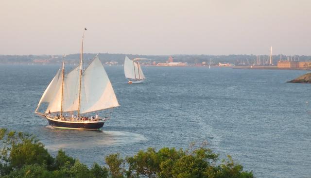 Two charter schooners sail in Newport, Rhode Island.