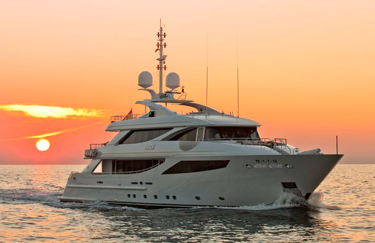 Aziza minimalist megayacht motoring at sunset