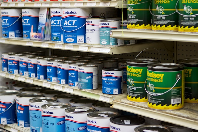 A photo of shelves full of bottom paint.