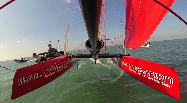 A photo of Philippe Presti (at the helm), the coach of Team Oracle USA, tests Flying Phantom in Normandy, France.
