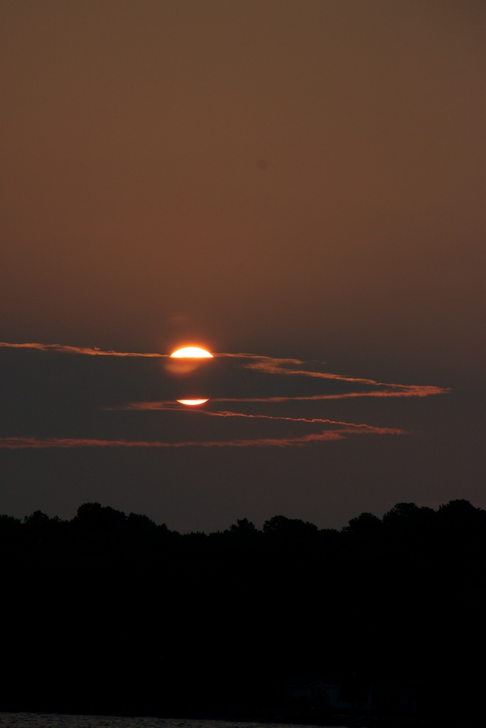Clouds appear to split the sun in two in this picture from an early morning crabbing trip near Kent Island, MD,