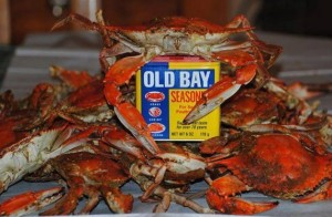 A can of Old Bay Seasoning and crabs.