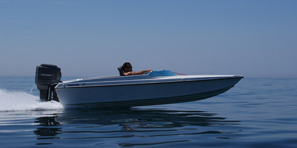 Phantom 16 runabout going fast