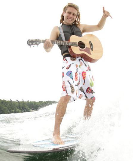 He surfs, sings and plays guitar. All at once!