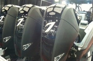 Triple blck 557s adorn the transom of a black Midnight Express 39 Open at the 2013 Miami Boat Show.