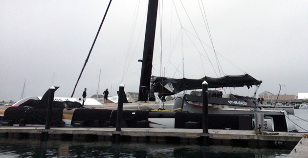 The MOD70 Spindrift Racing waits for a weather window at Newport Shipyard.