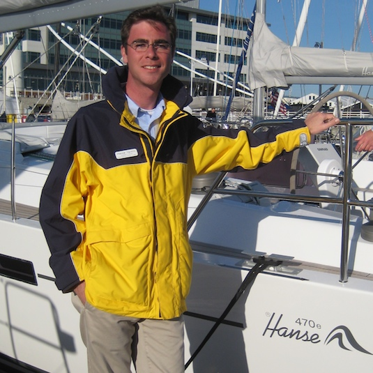 Hanse Yacht's new North American Sales Director, Alex Harrison, poses in front of the 470, seven of which have sold worldwide in the last three weeks.