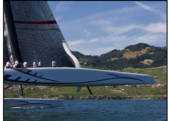 Alinghi 5 flies a hull in early training.