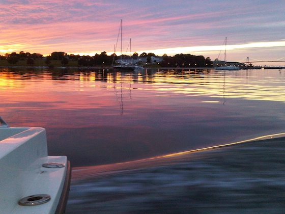 The view of the sunset across Fort Adams, from the stern of Aloha, the Ida Lewis Yacht Club launch