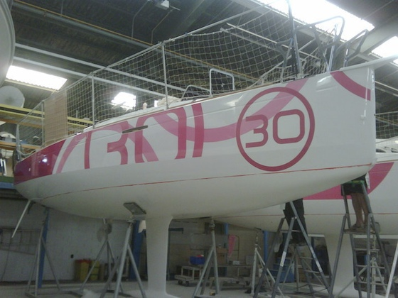 Lined up at the factory, fast new 30-footers from Beneteau get the hot pink treatment.