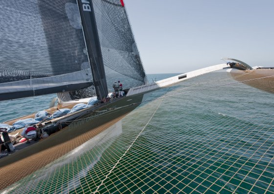 BMW Oracle Racing's 90-foot trimaran flies two hulls during testing.