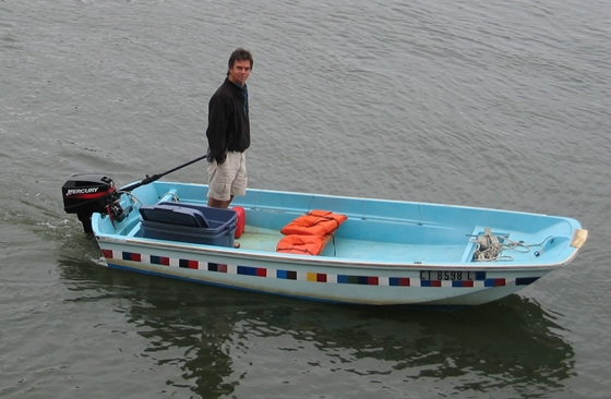 This is the 1967 Boston Whaler 13 early in the new millennium, with its fifth engine – a Mercury 8-hp two-stroke, which gets the boat on a plane with two people in it if they sit in the right places.  (The older we get, the slower we go, and the easier the engine to lift.) The colorful squares are part of a topside paint test for Practical Sailor. Today the topsides are all platinum gray.