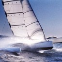 The 40-foot Ocean Surfer, designed by Dick Newick for Mark Rudiger and the 1988 CSTAR. Note the battens and internal wishbone in the jib, and the graceful arc of the akas. Photo courtesy Newick website.