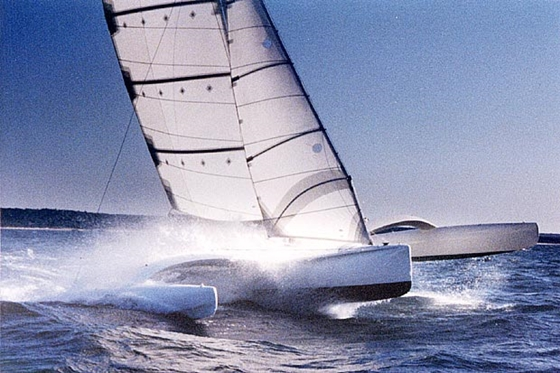 The 40-foot Ocean Surfer, designed by Dick Newick for Mark Rudiger and the 1988 CSTAR. Note the battens and internal wishbone in the jib, and the graceful arc of the akas. Credit: Newick website.