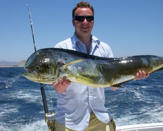 John with his dorado. (Brothers being brothers, Adam is holding out on the photo of John's striped marlin.)