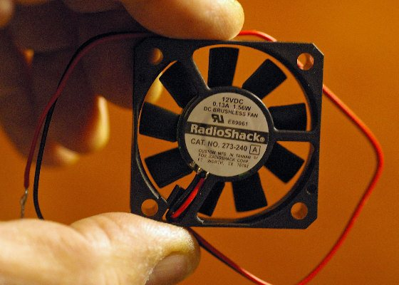 This small, low-wattage fan can help keep electronics cool. Make sure the blades are exposed to fresh air.