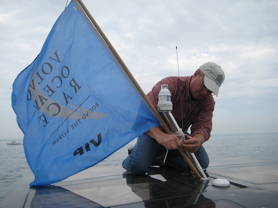 """Flagman"" Bill Bolin, of Island Packet Yachts, does a seamanlike job of hoisting our VIP flag, which gave us closeup access to the boats while racing."