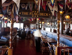 The Bitter End's Clubhouse bar and adjoining dining room are decorated with ship models, pennants, burgees from around the world.