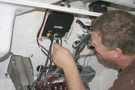 Flush mounting electronics requires a good look from behind; note the position of the red and black wires, which had to be moved out of this fishfinder's way.