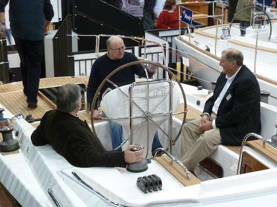 Richard Matthews (right) discusses his new Gunfleet 43. The center cockpit features a console with a wraparound steering wheel.