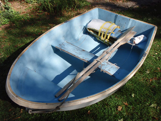 With the outside of the hull painted fresh after 34 years, the inside of this dinghy of uncertain pedigree could use the treatment too. Full equipment list: a pair of oars, two PFDs, and a bailer.