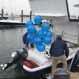 At the christening, an outboard popped out of Godspeed's garage.