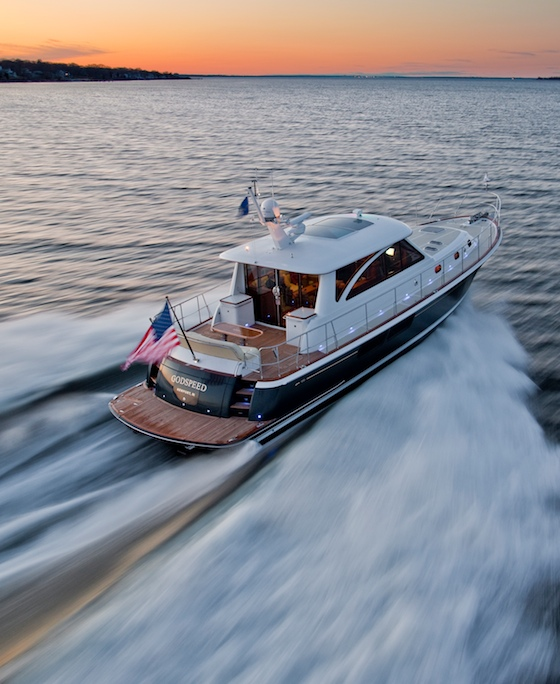 The 52's sleek, low-sheer look disguises its spacious living area on deck and in the deck saloon.