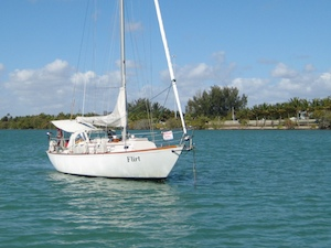 The cruising sailboat Flirt, at anchor near Miami Beach