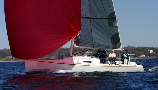 The J/95 flies an asymmetric spinnaker from a retractable sprit or prod.