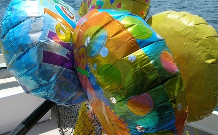 Mylar balloons travel the world, fall in the ocean, cause lots of trouble, and don't degrade for a long time. But they're fun to catch in a net, and they pack down small in the garbage once they've been filleted.
