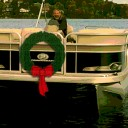 Pontoon boat for holiday shopping with wreath