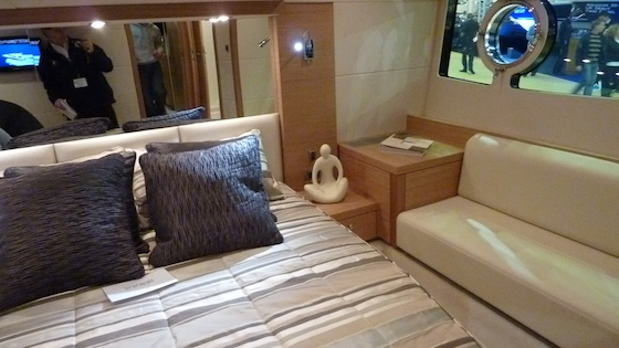 The master stateroom, with seating and a large window outboard on either side.
