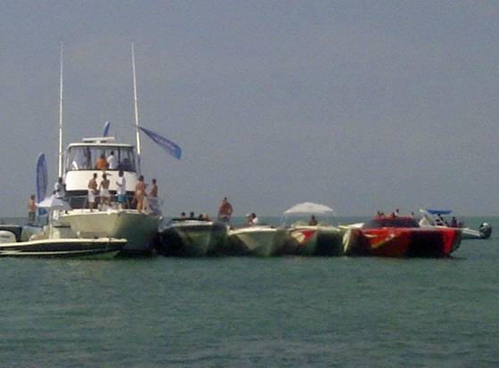 The 54-foot Mediterranean motoryacht in the center of this line was headquarters for the Sandbar Party Raft-Off.
