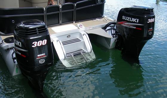 Twin Suzuki DF300 outboards power this Premier Grand Entertainer 290 luxury pontoon boat.