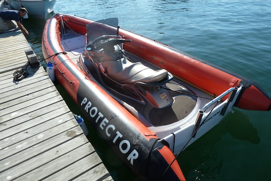 The Protector Jet fits a Yamaha PWC in the center section molded into its fiberglass hull. The transom looks remarkably naked without an outboard engine.