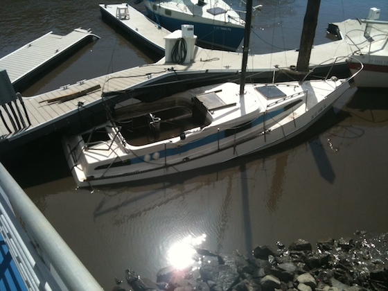This center-cockpit sloop ended up underneath a dock in Santa Cruz Harbor when the tsunami's surging waves subsided. Chuck Hawley photo