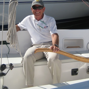 Tom Schock at the helm of a Harbor 25.