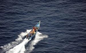 Suspected Somali pirates fleeing the scene.