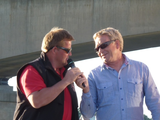 Martin Rygh (left), Norway's top skipper and winner of the first race on Monday, is interviewed during the club barbecue by top local sailor Hans Johansson.