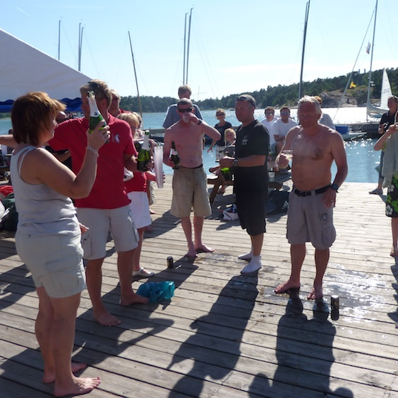 Champagne on the Stenungsund Sailing Club docks; Urban Ristorp at right.