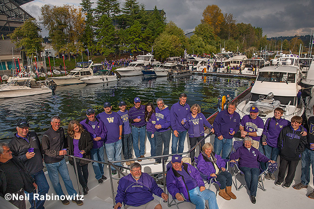 Frank (lower 2nd from left) and Jeannie Miles (lower right) have had 42 tickets to each home game for 50 years and not missed a home game in all that time. Their boat, Big Dog, swarms with family and friends and is built with football games in mind.
