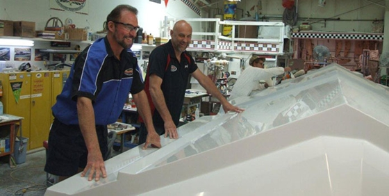 Wayne (in foreground) and Joe Schaldenbrand with the hull plug for their new 34-foot center-console.