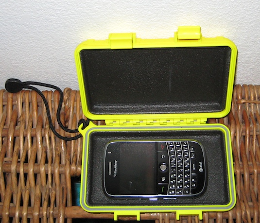 The Blackberry Bold in a waterproof Otterbox case that would fit iPods and other electronic devices for safekeeping while on the water.