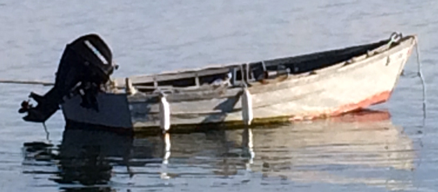 wooden fishing skiff at rest