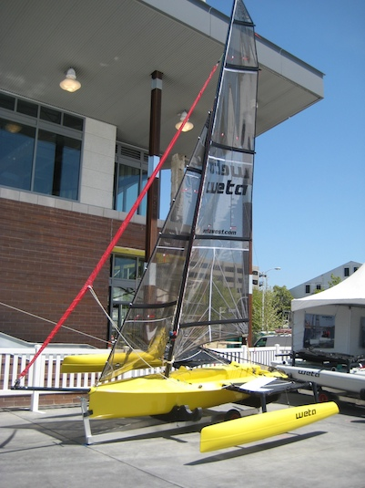 A friend has already sailed this hot little trimaran from New Zealand, the Weta. It's hard to tip over, but has a clever self-righting system (which my friend Alan found came in handy).