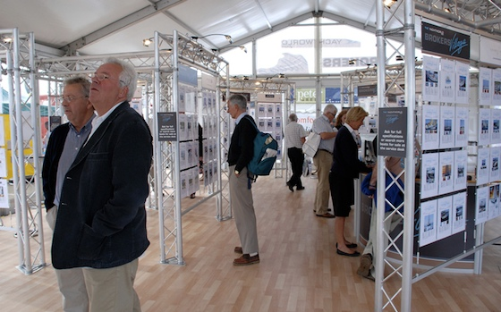 Visitors to the Southampton Show browse yachts for sale at the Yacht Brokers Village by YachtWorld.com.